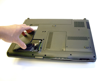 replace hard drive bay cover into dv9000 notebook