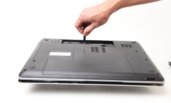 Remove bottom cover of HP dv7 by loosening screw at bottom as shown in photo